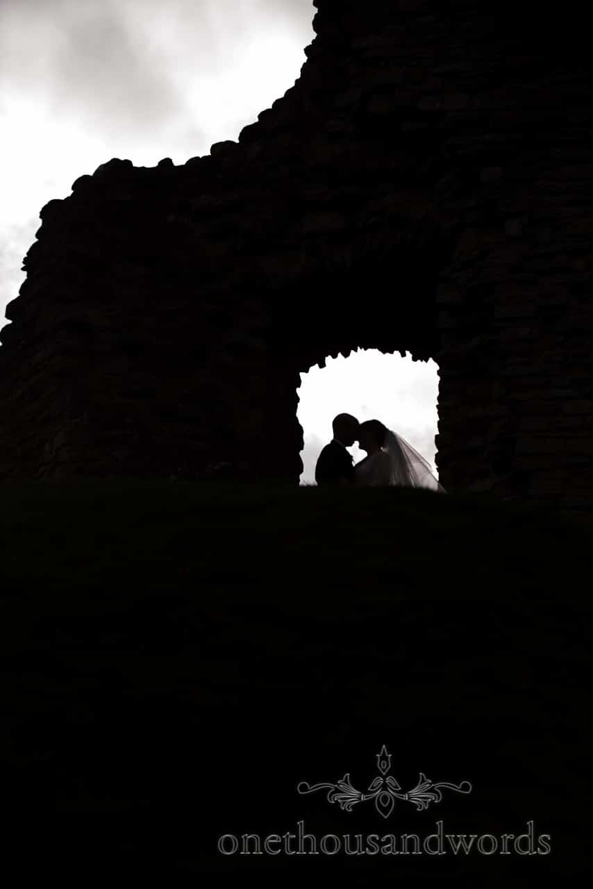 Bride and groom silhouette wedding photograph in Christchurch Castle, Dorset