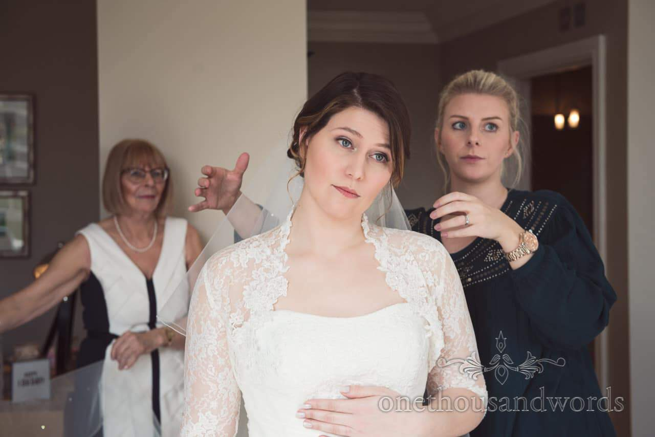 Bride has wedding veil attached by Fiona Lucy Clark Hair and MUA