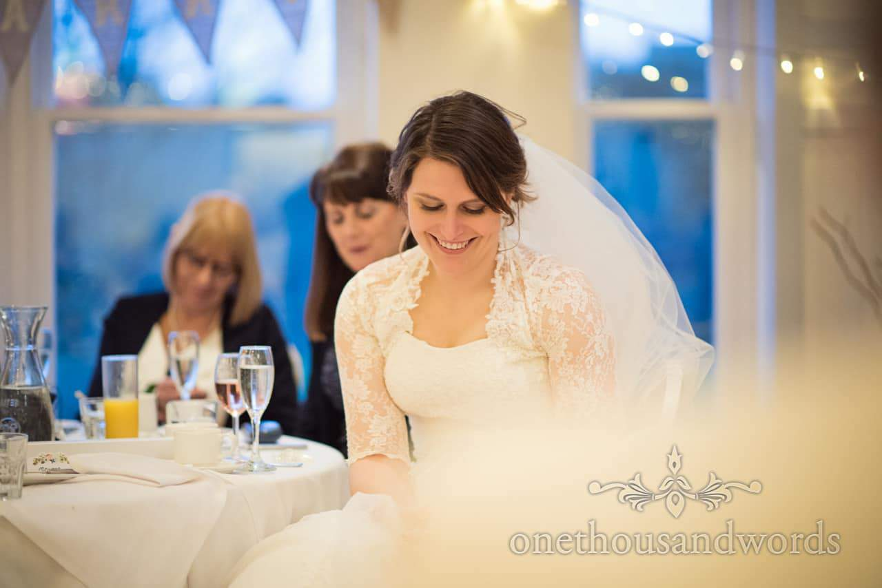 Bride laughs at grooms speech at Kings Arms Hotel wedding venue in Dorset