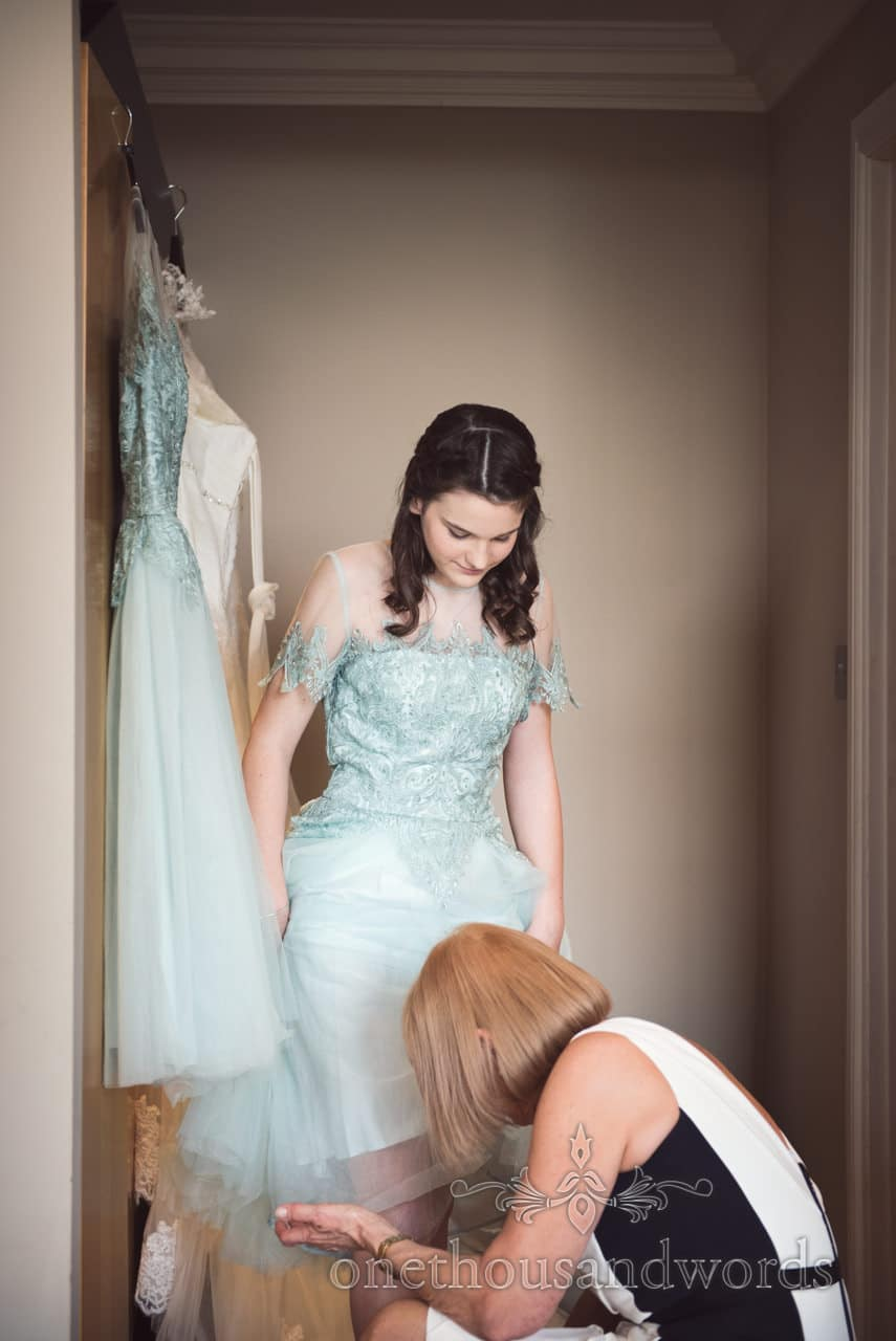 Bridesmaid in detailed aqua marine bridesmaids dress on dorset wedding morning