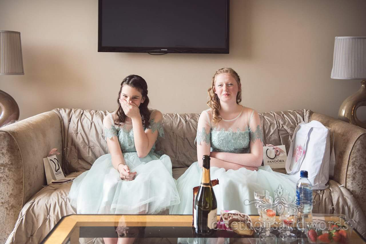 Bridesmaids laughing in aqua marine bridesmaids dresses at Kings Arms Hotel