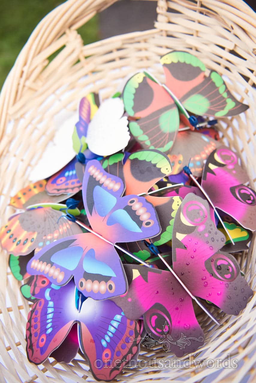 Colourful foam butterflies in basket ready to be used as wedding confetti
