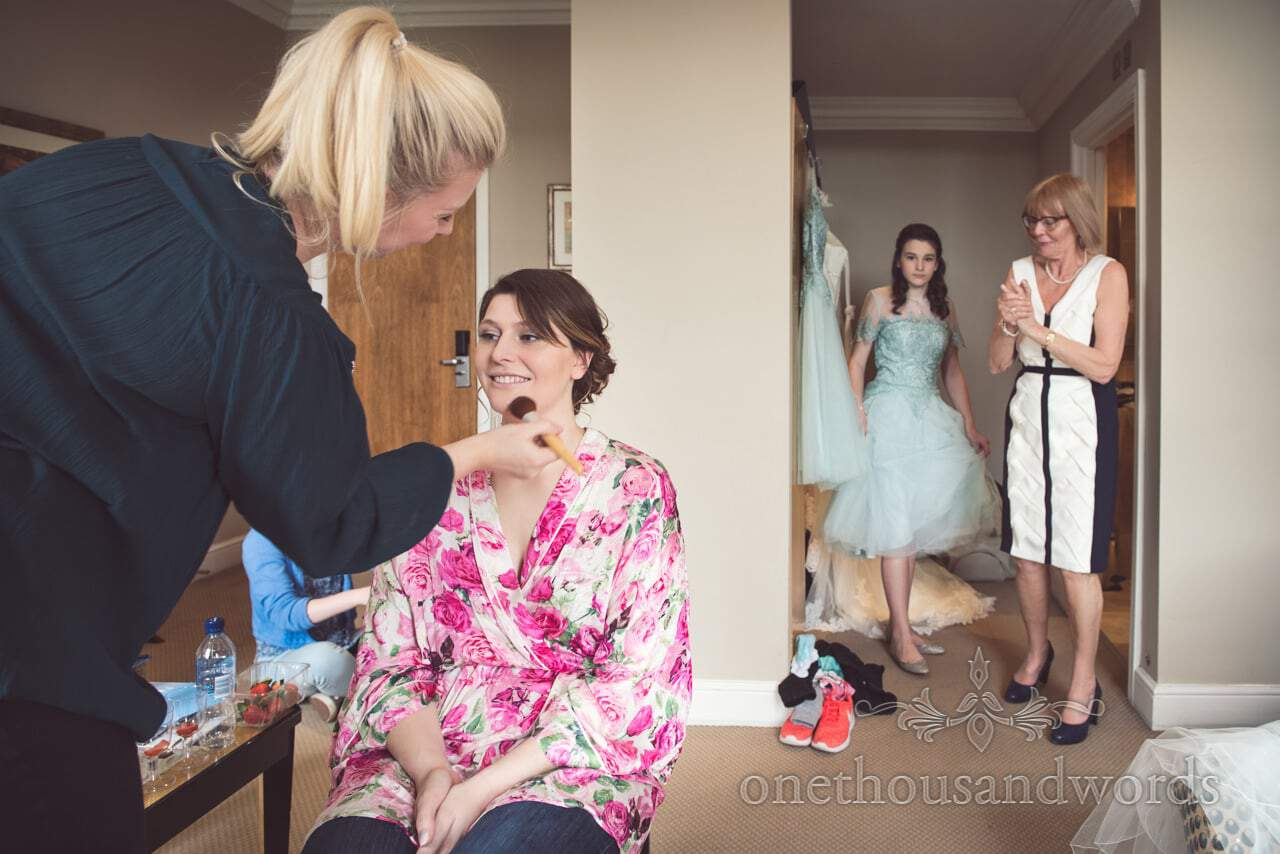 Documentary bridal wedding preparation photograph with MUA