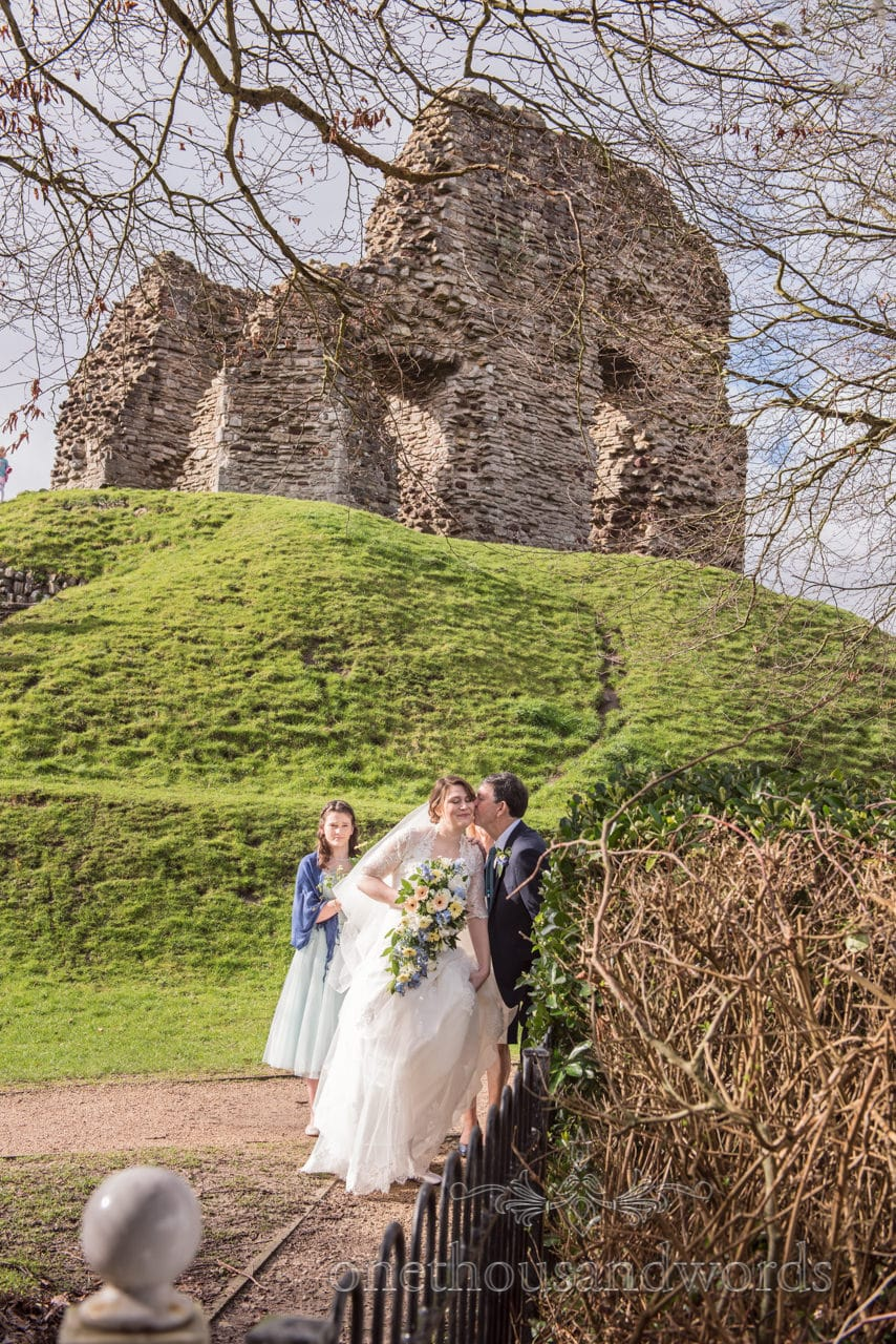 Emotional moment between bride and her father below Christchurch Castle, Dorset