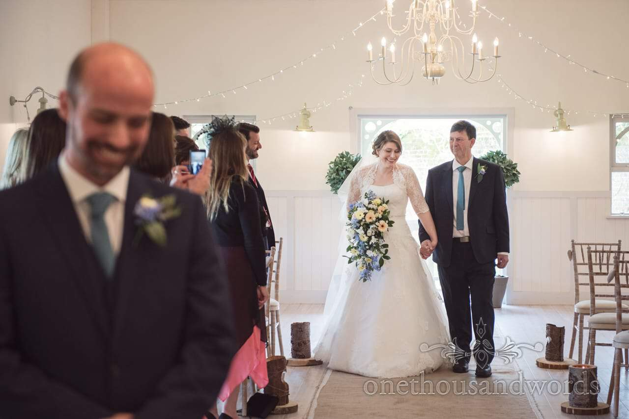 Father of bride walks bride down aisle at Kings Pavillion wedding in Dorset