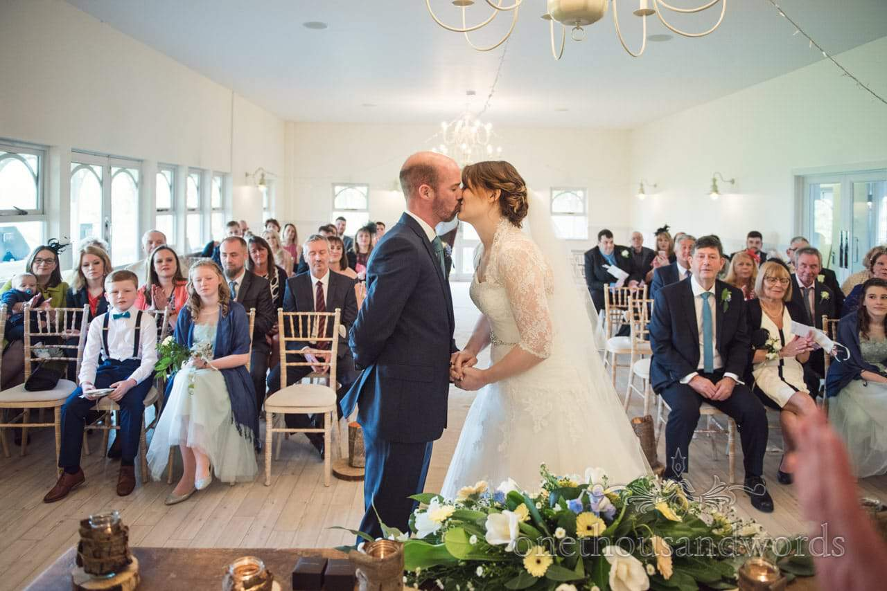 First kiss photograph at Kings Pavillion wedding venue in Christchurch Dorset