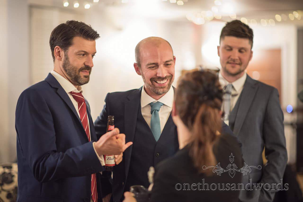 Groom with wedding guests at Kings Arms Hotel evening reception