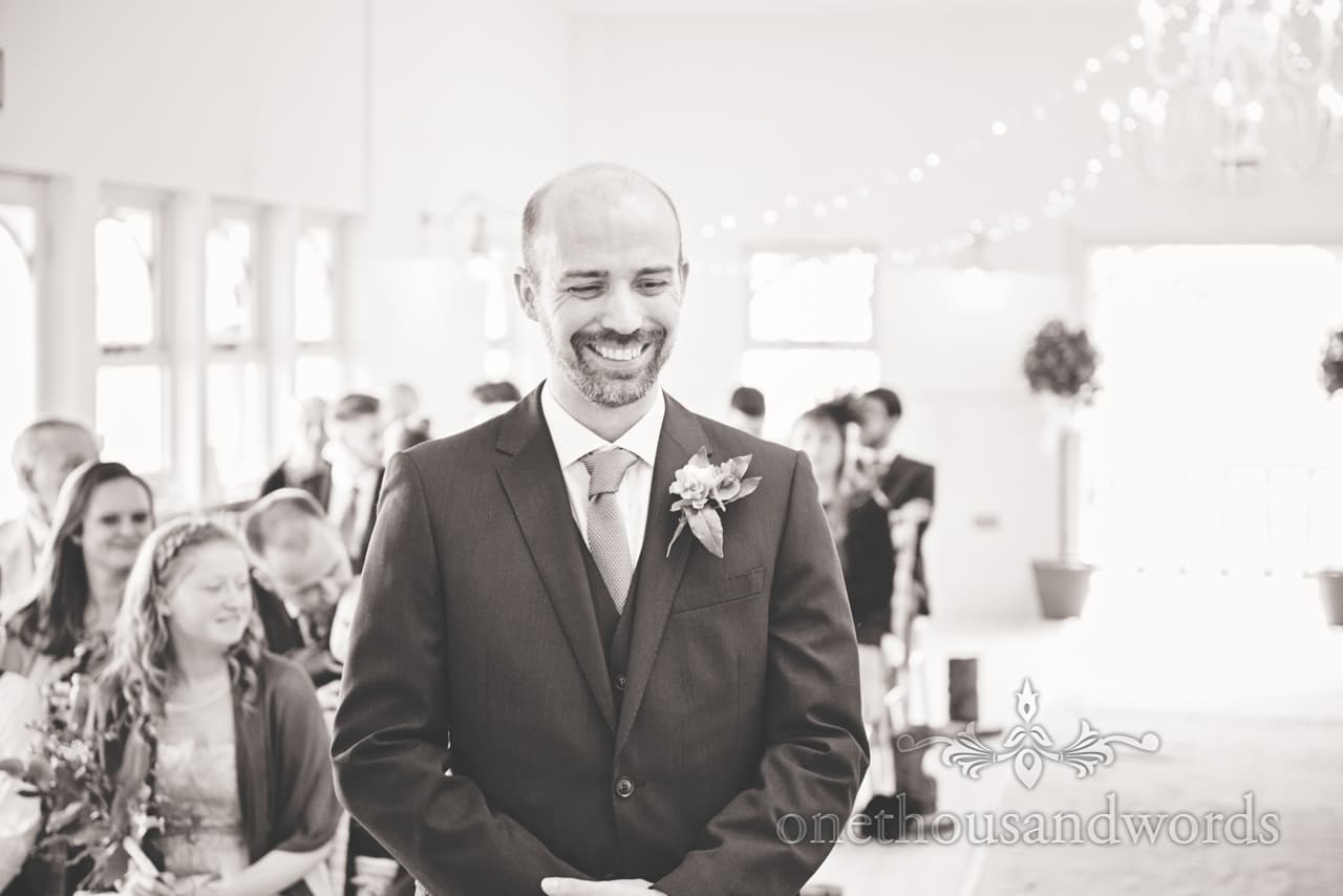 Happy groom waits for his bride at Kings Pavillion wedding ceremony in Christchurch