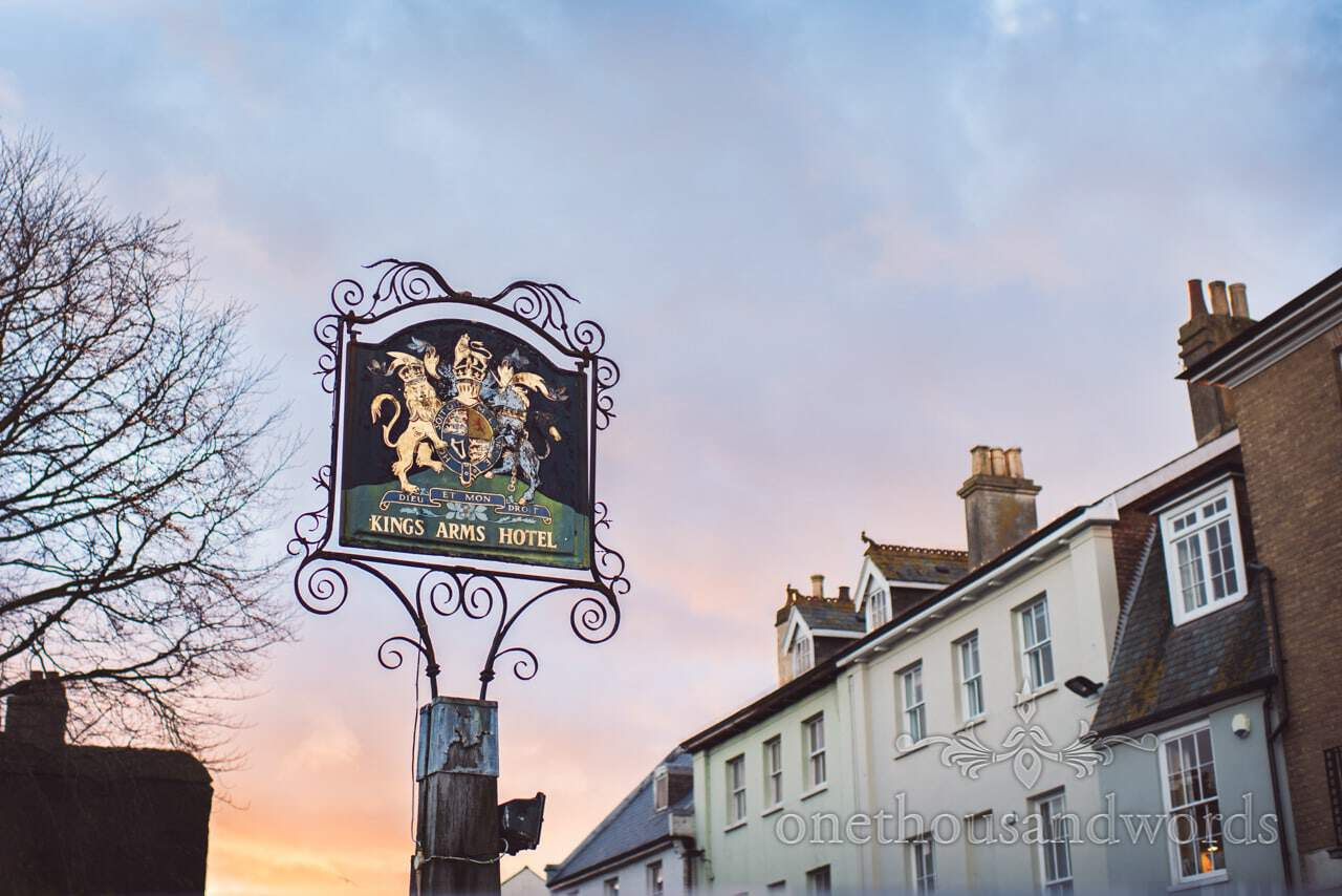 Kings Arms Hotel Wedding Venue in Christchurch Dorset pub sign at sunset