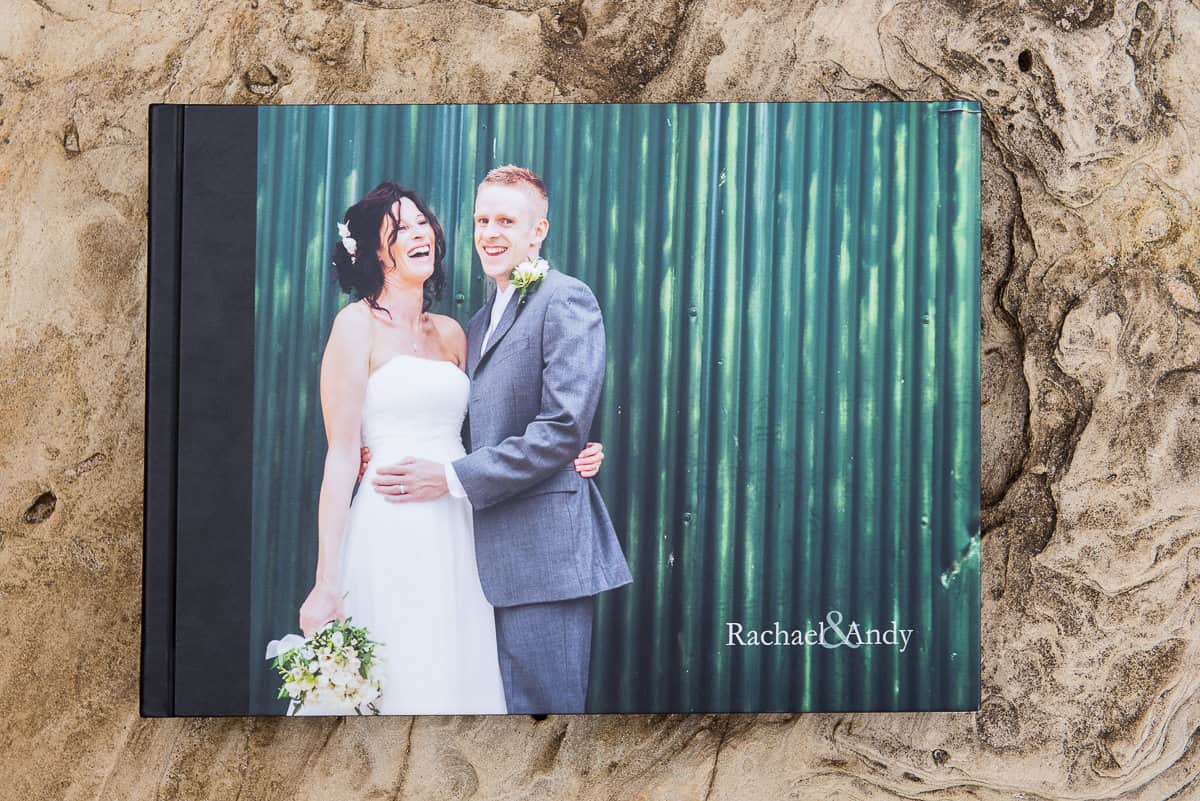 Leather bound wedding photography album with photographic cover