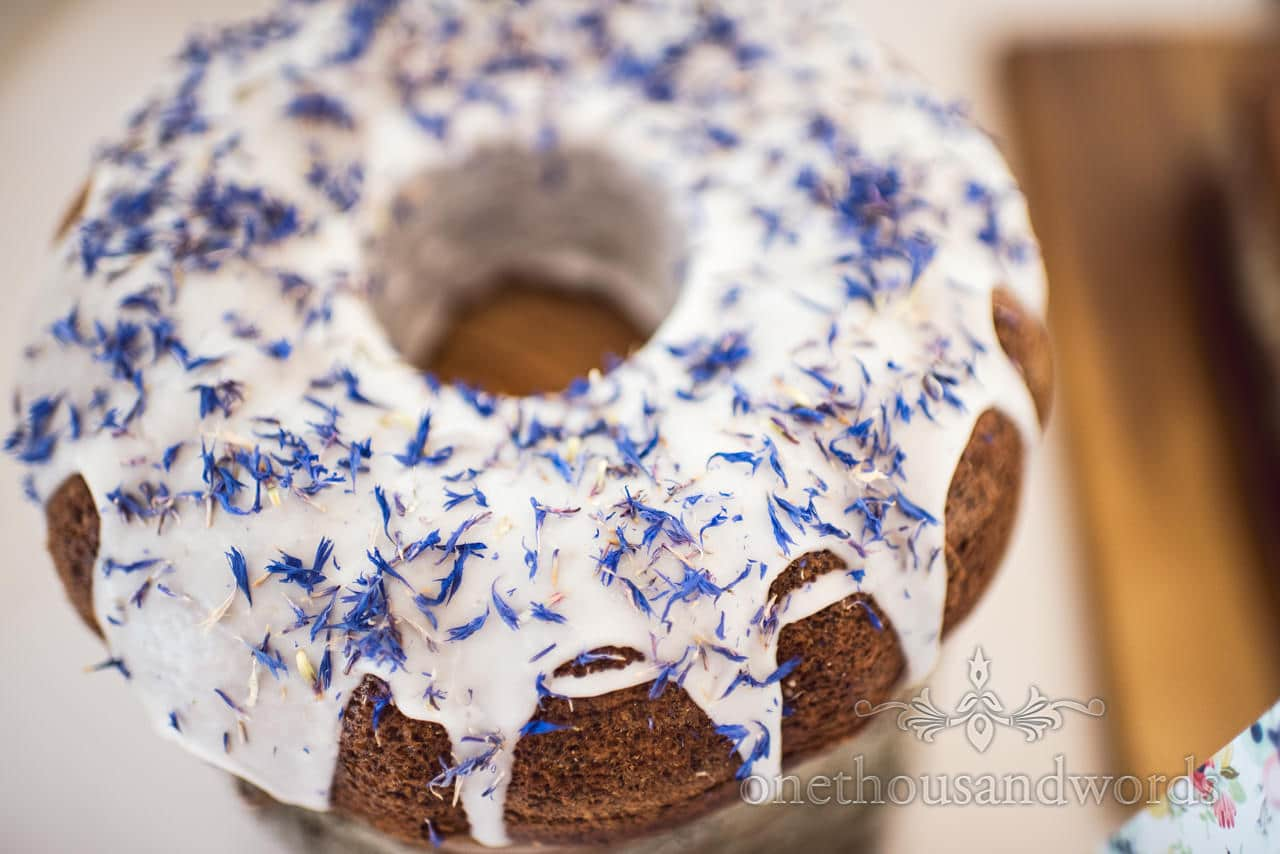 Lemon and earl grey tea iced ring wedding cake with blue flower decoration