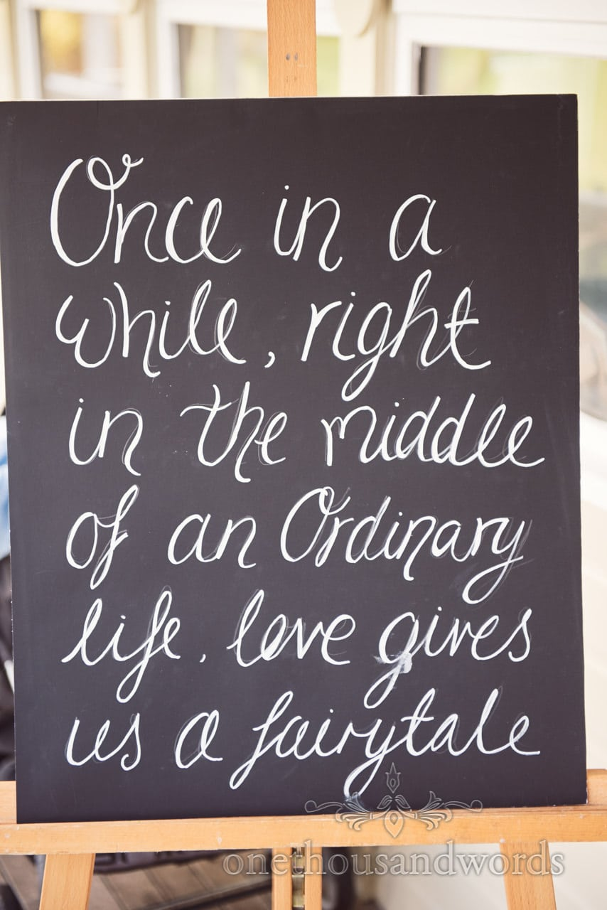once in a while love and fairytale wedding chalkboard sign on easel