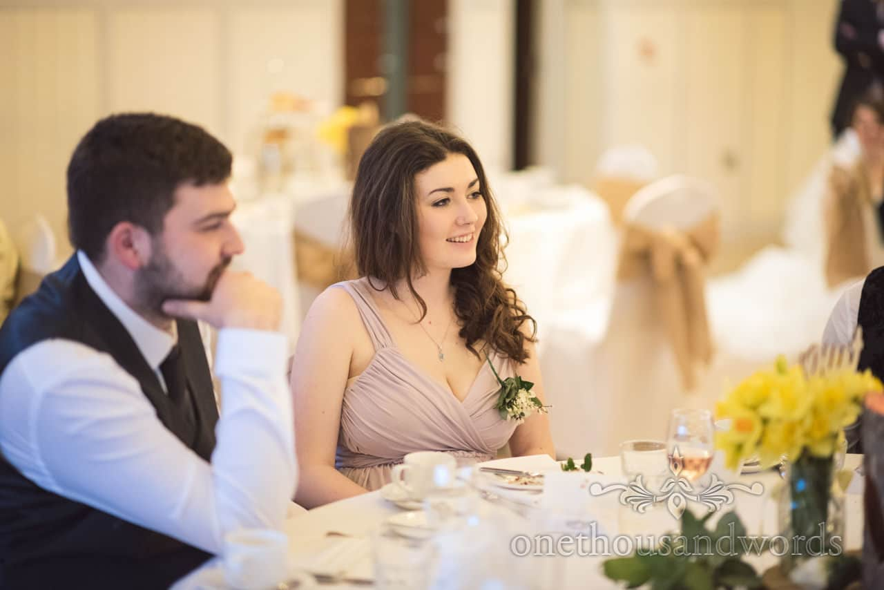 Portrait image of wedding guest in greco roman style dress at Chirstchurch wedding