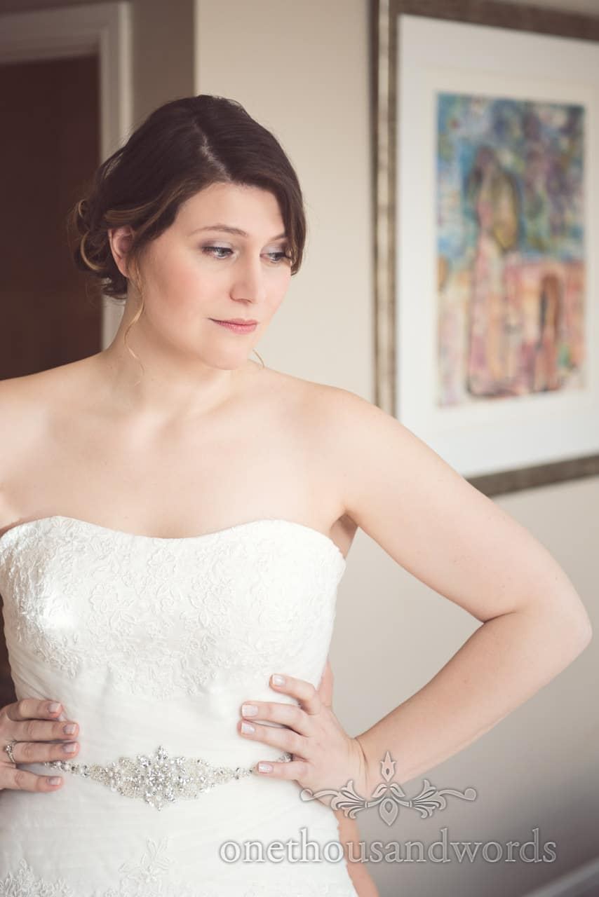 Portrait of bride in beautiful white detailed wedding dress with diamantes