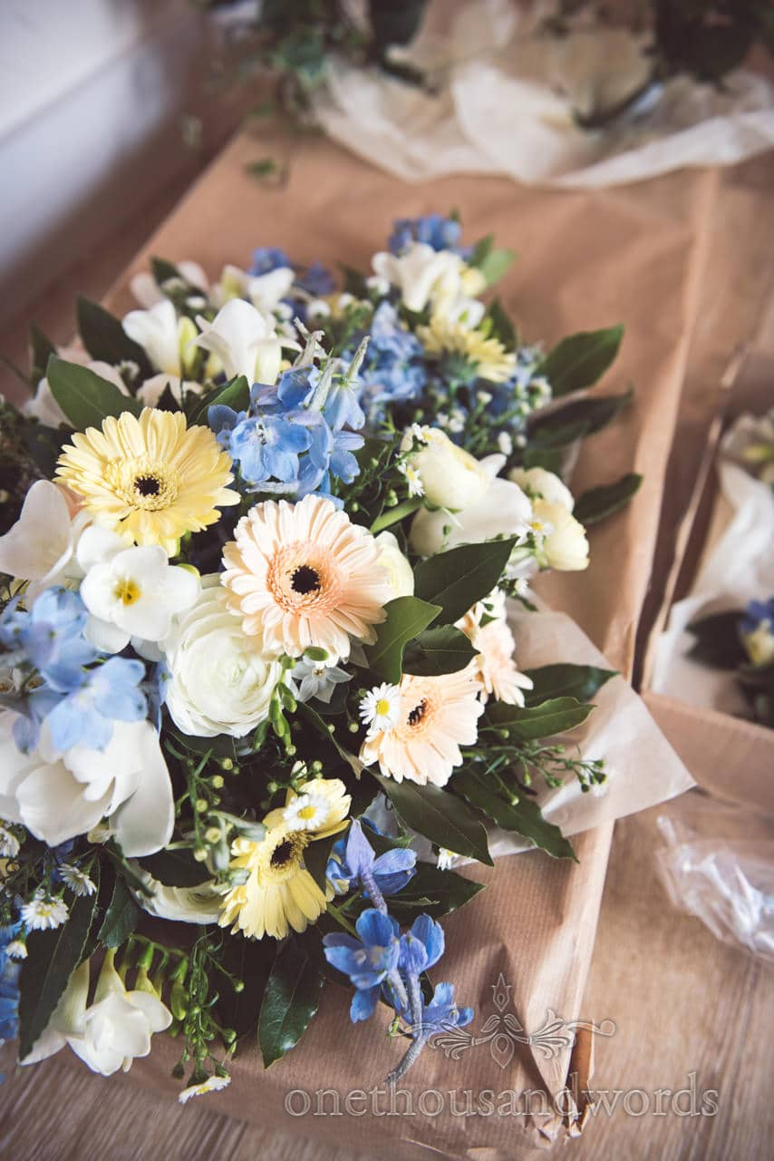 Soft pastel pink, yellow, blue and white wedding flowers bouquet