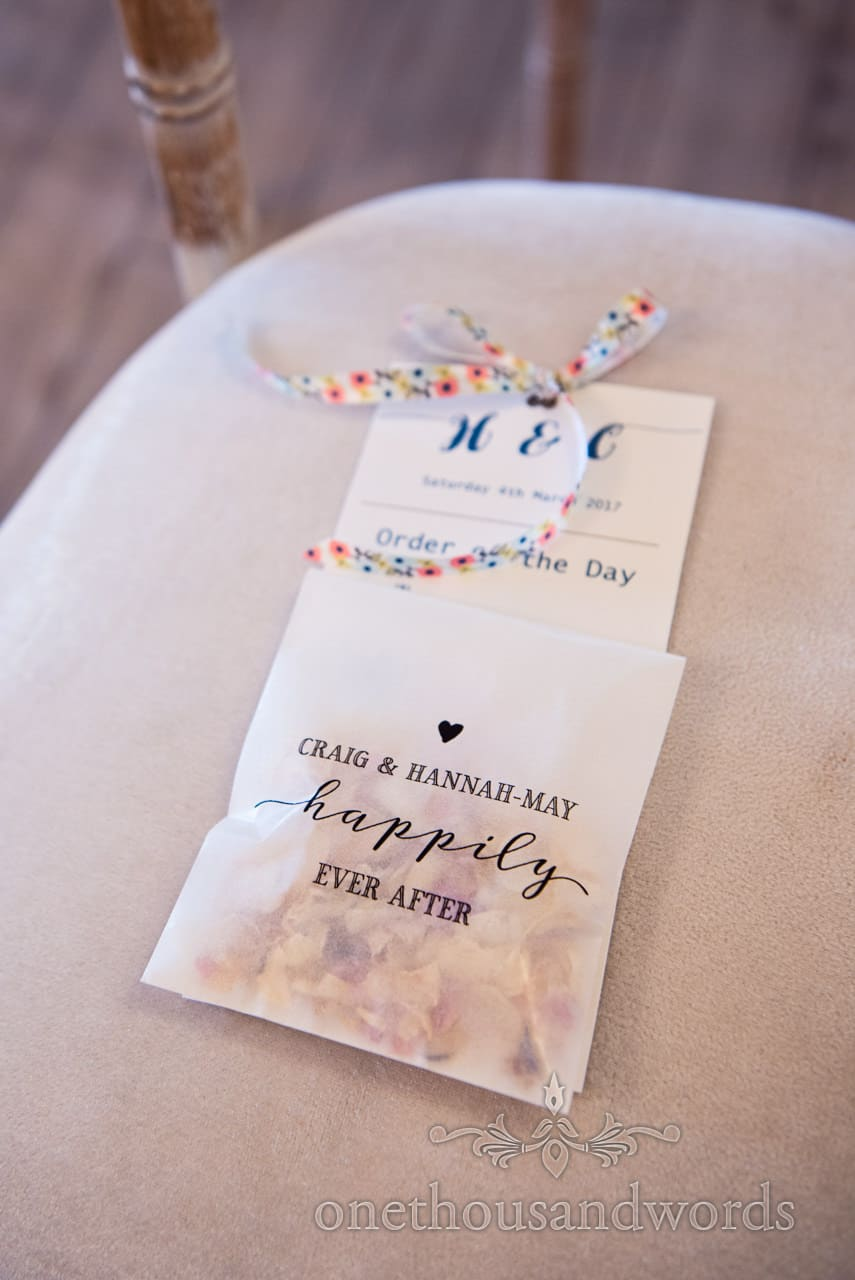 Wedding confetti and order of the day detail photograph