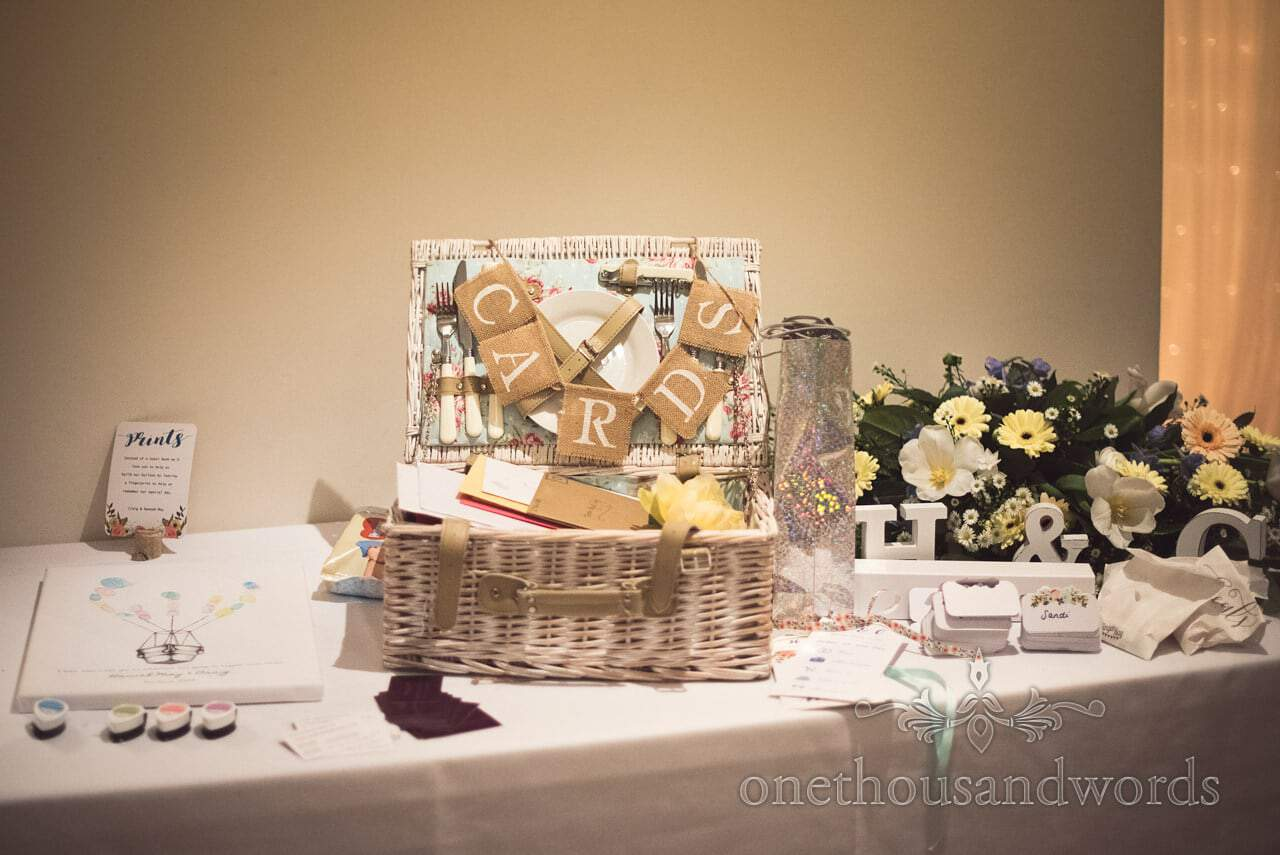 Wedding detail photograph of wedding cards hamper with wedding flowers