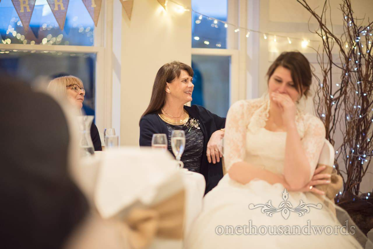 Wedding guests laugh at groom's wedding speech at Kings Arms Hotel