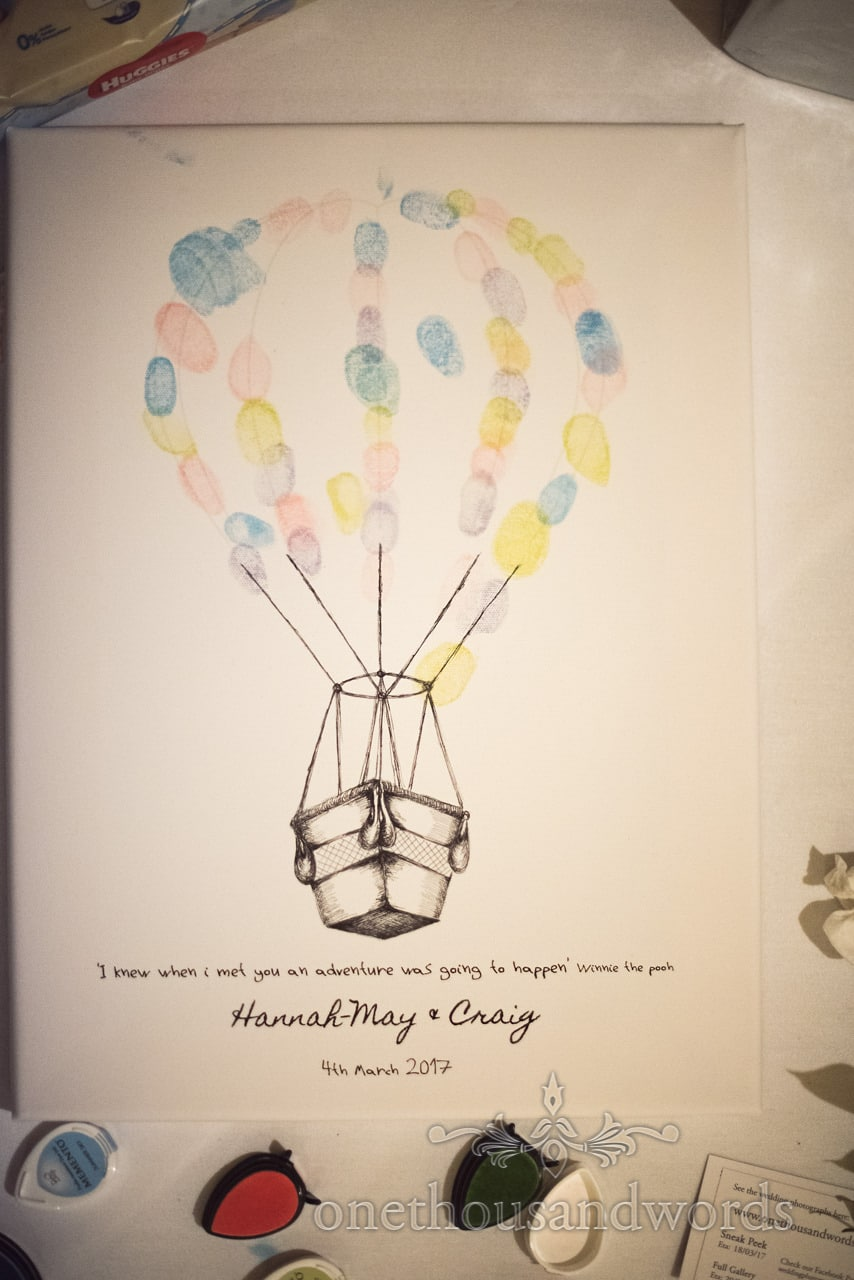 Wedding thumbprint signing book in shape of hot air baloon