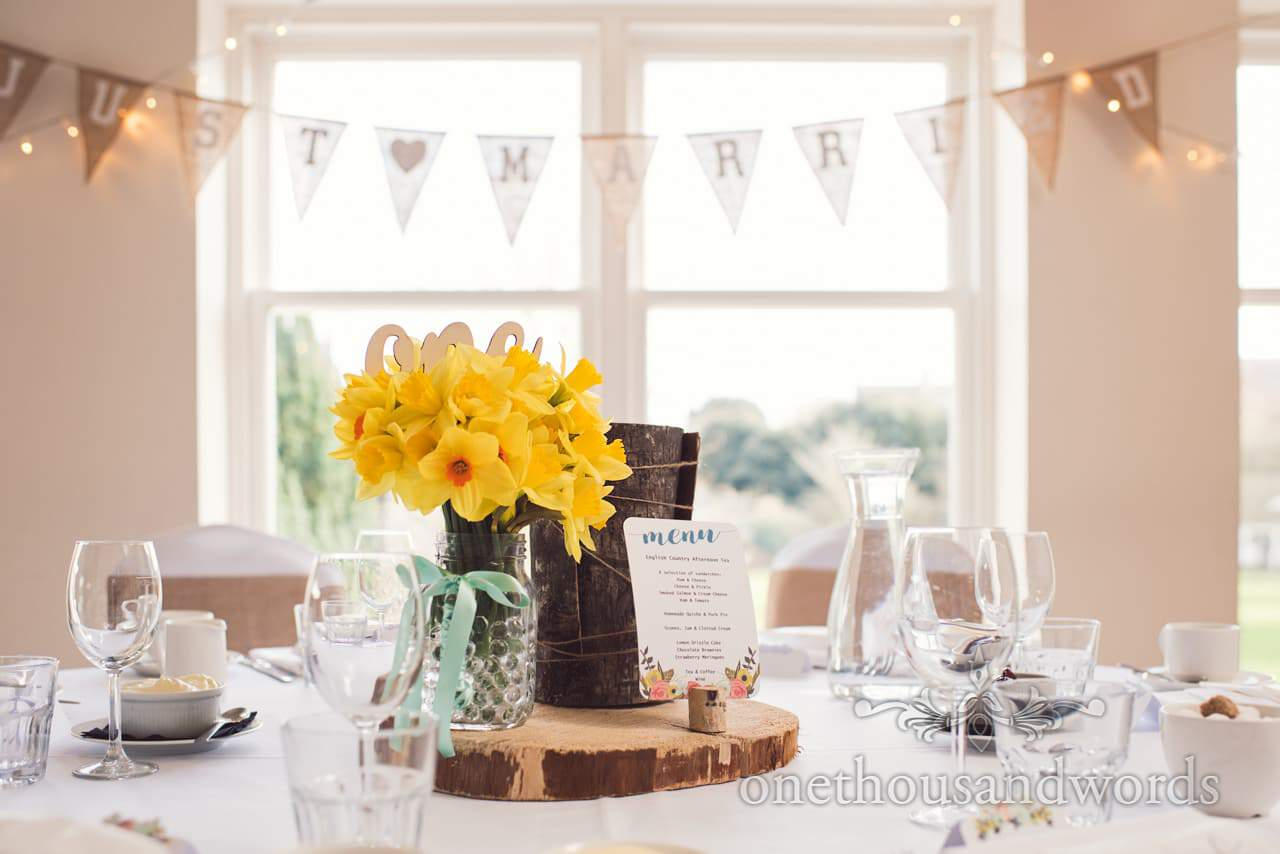 Woodland theme wedding decorations, hessian bunting and spring daffodils