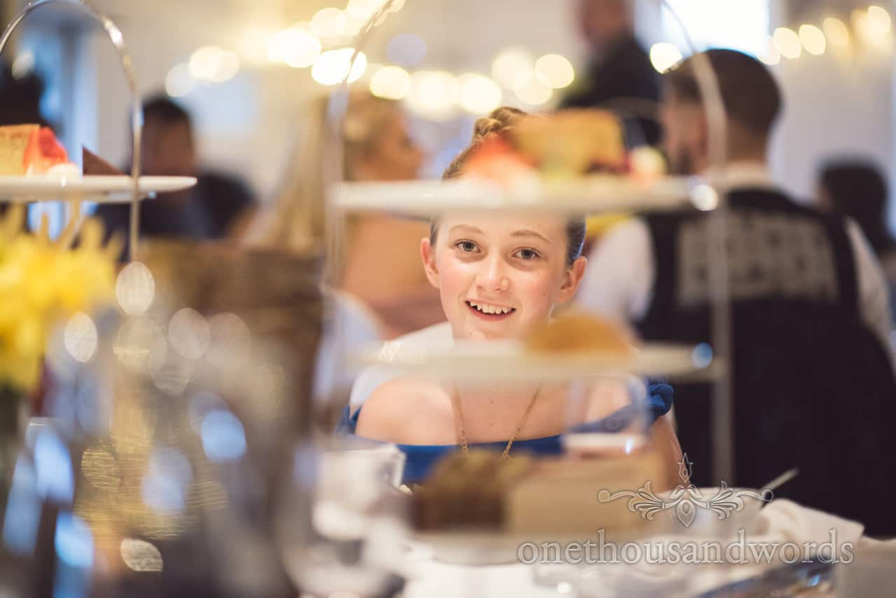 Young wedding guest looks at high tea wedding breakfast at Kings Arms Hotel