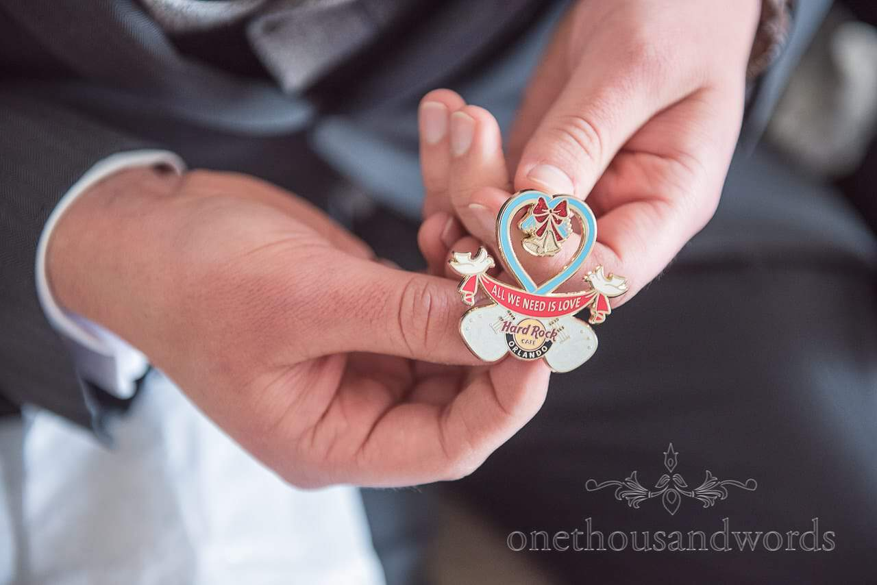 All you need is love pin badge gift from Scaplens Court wedding photographs