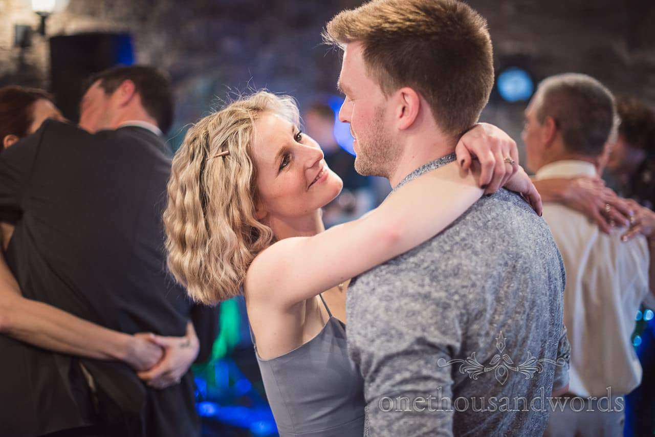 An embrace on the dance floor at Scaplens court wedding photographs