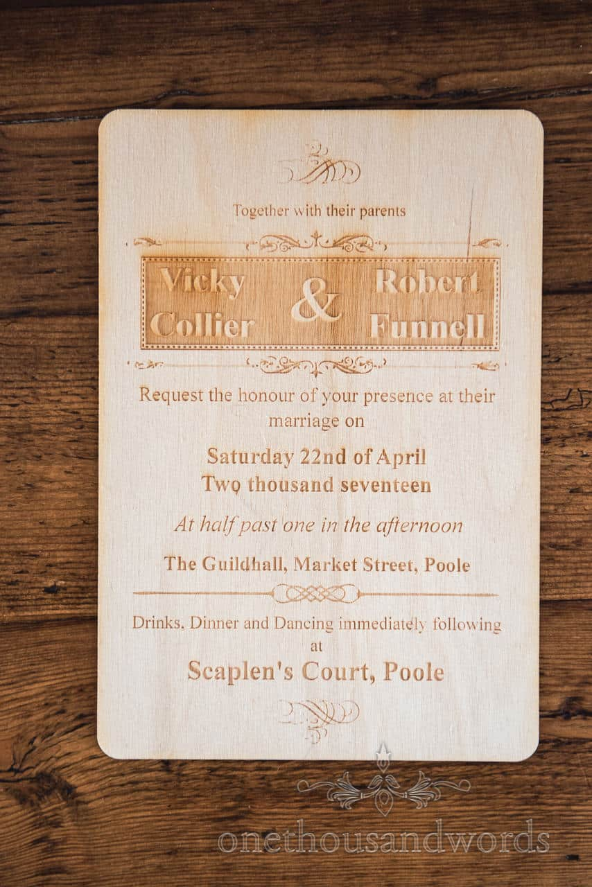 Bespoke wooden wedding invite from Scaplens Court wedding photograph