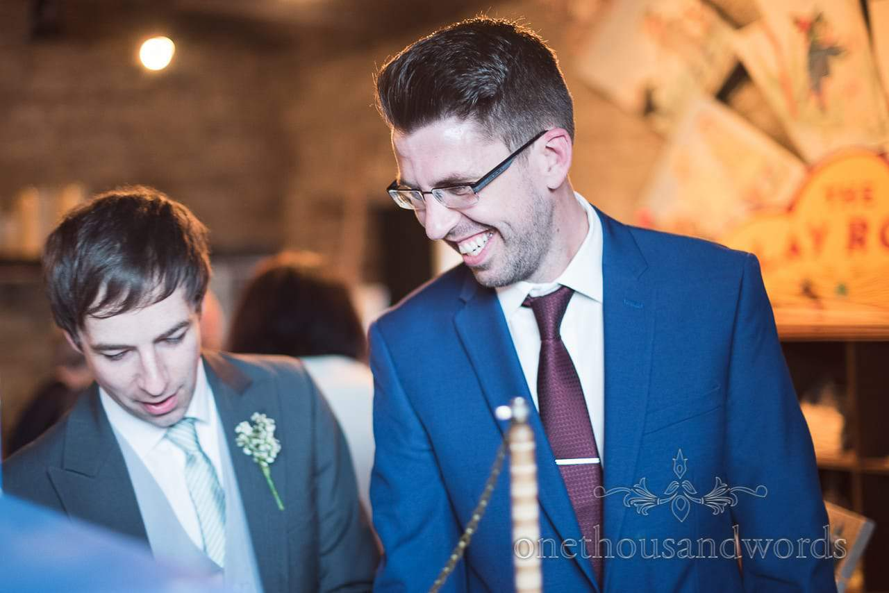 Best man and guest in playroom at Scaplens court wedding photographs