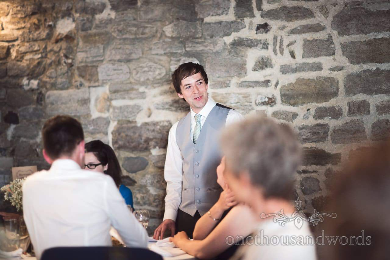 Best man delivers speech at Scaplens court wedding photographs