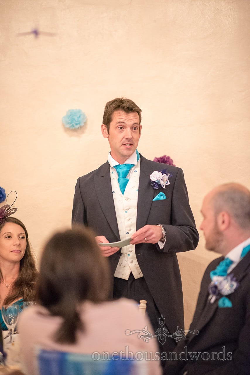 Best man while delivering speech at Walton Castle wedding photographs