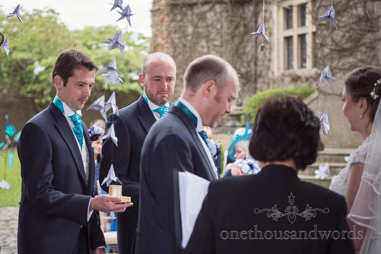 Best men looking emotional during ceremony at Walton Castle wedding photographs