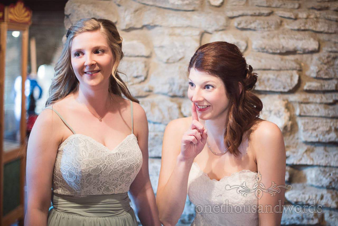 Bride and bridesmaid at Scaplens Court wedding photographs
