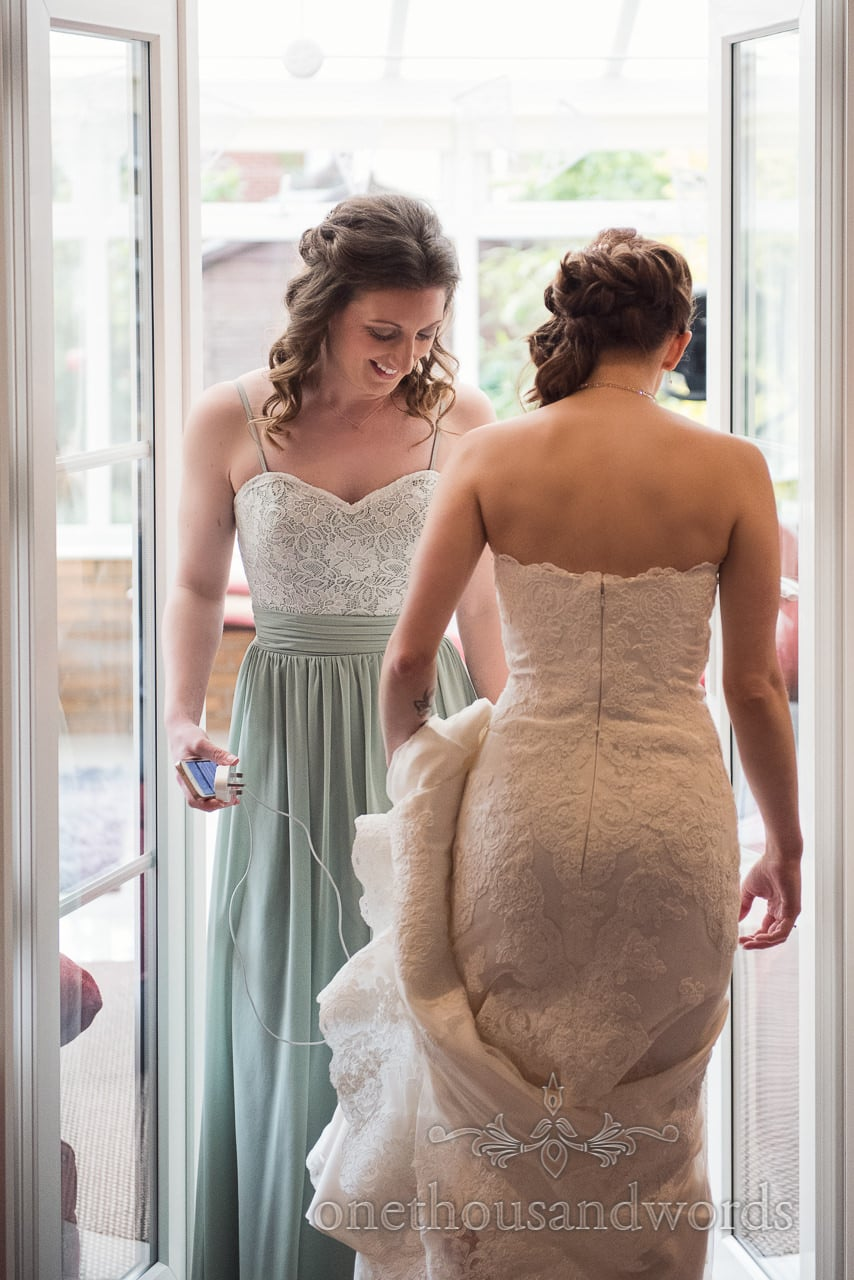 Bride and bridesmaid on morning of Scaplens Court wedding photographs