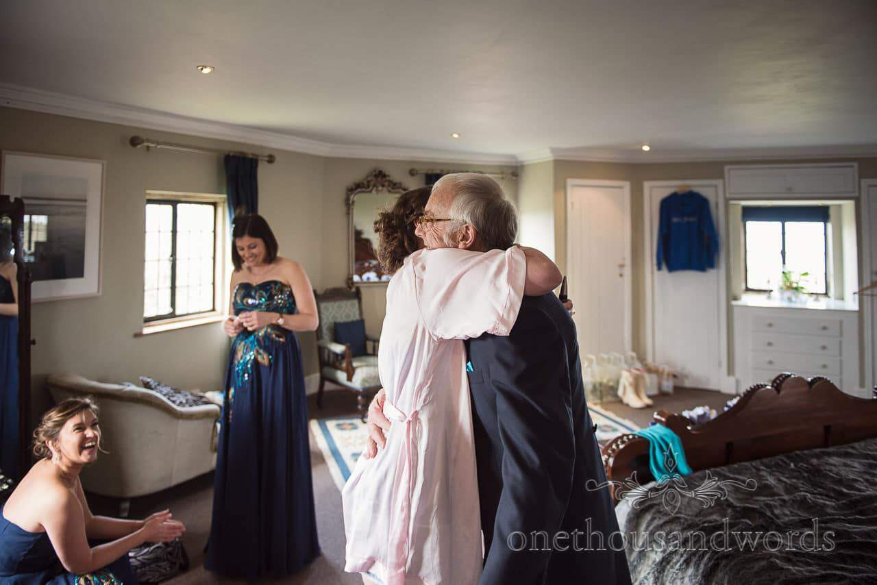 Bride and father embrace at Walton Castle wedding photographs