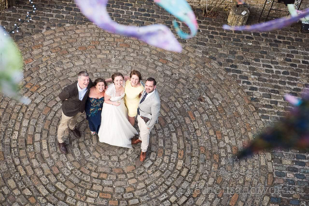 Bride and friends in courtyard at Walton Castle wedding photographs