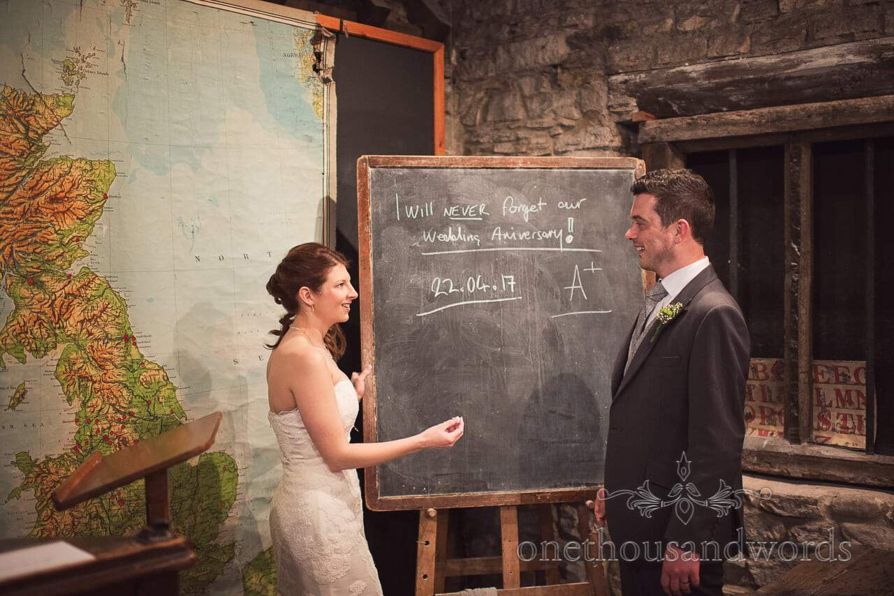 Bride and groom in classroom at Scaplens Court wedding photographs