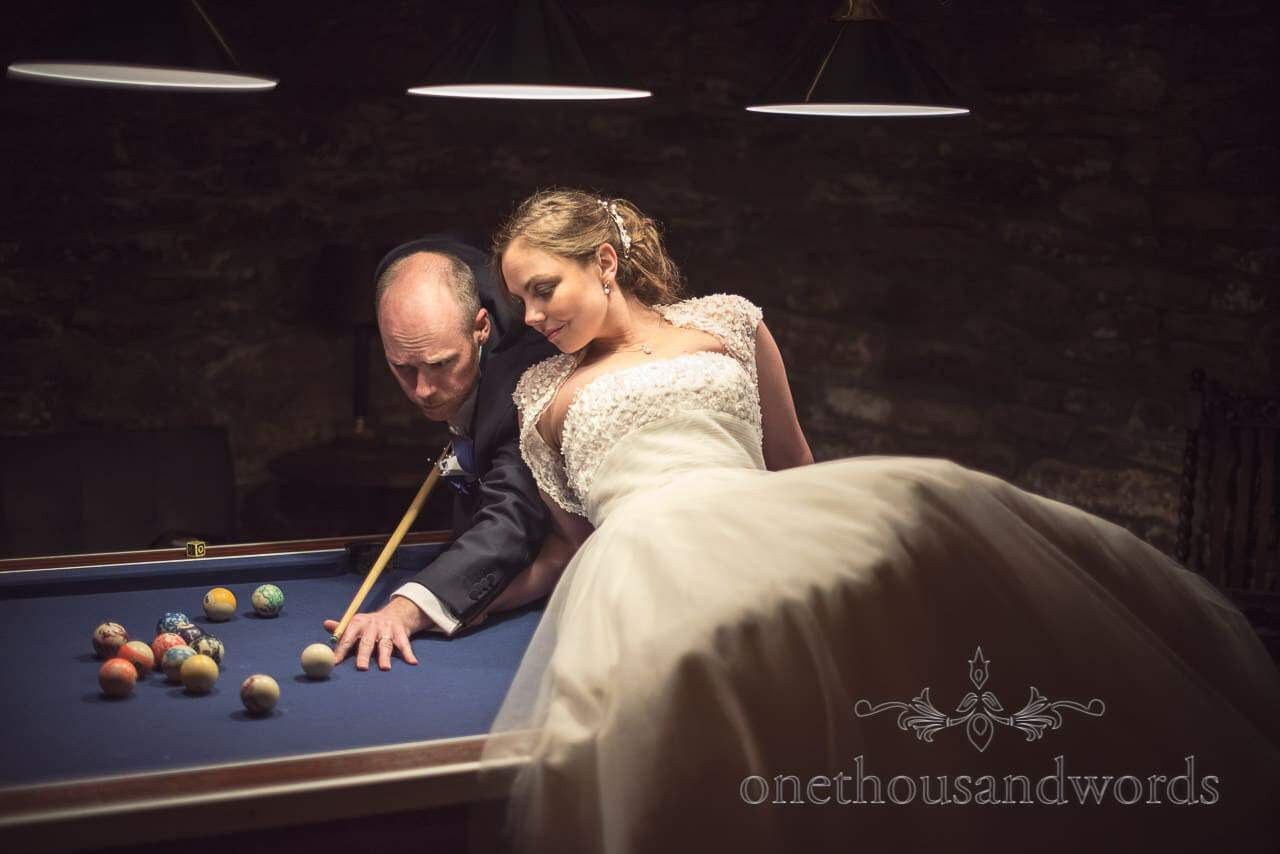Bride and Groom in pool room from Walton Castle wedding photographs