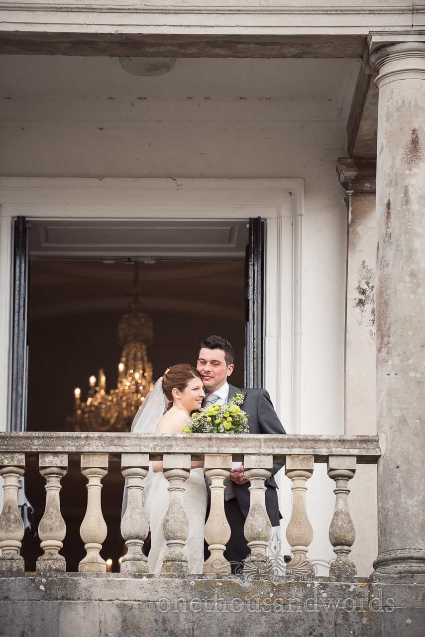 Bride and groom on balcony at Scaplens Court wedding photographs