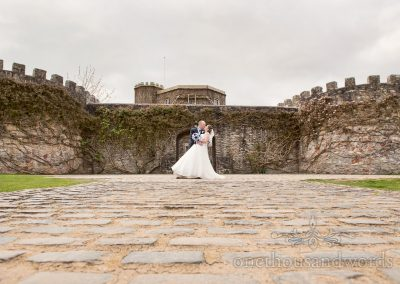 Bride and groom on driveway at Walton Castle wedding photographs