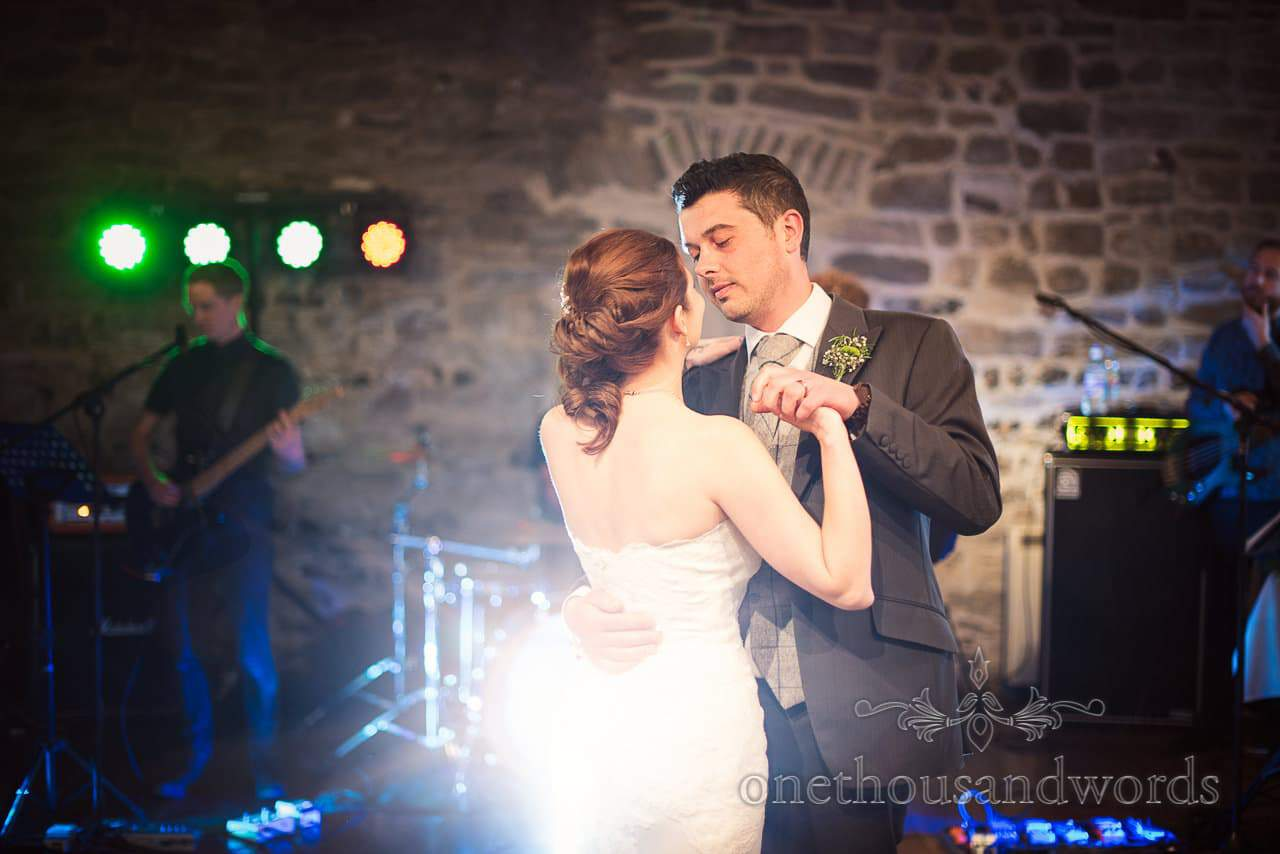 Bride and groom perform first dance at Scaplens court wedding photographs
