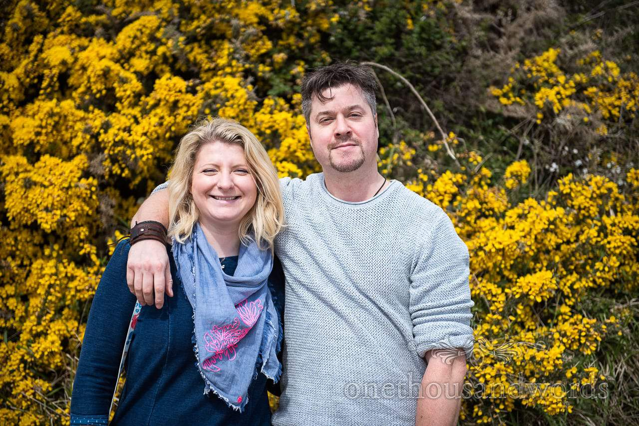 Bride and groom portrait photograph at Coastal engagement photo shoot with yellow gorse flowers