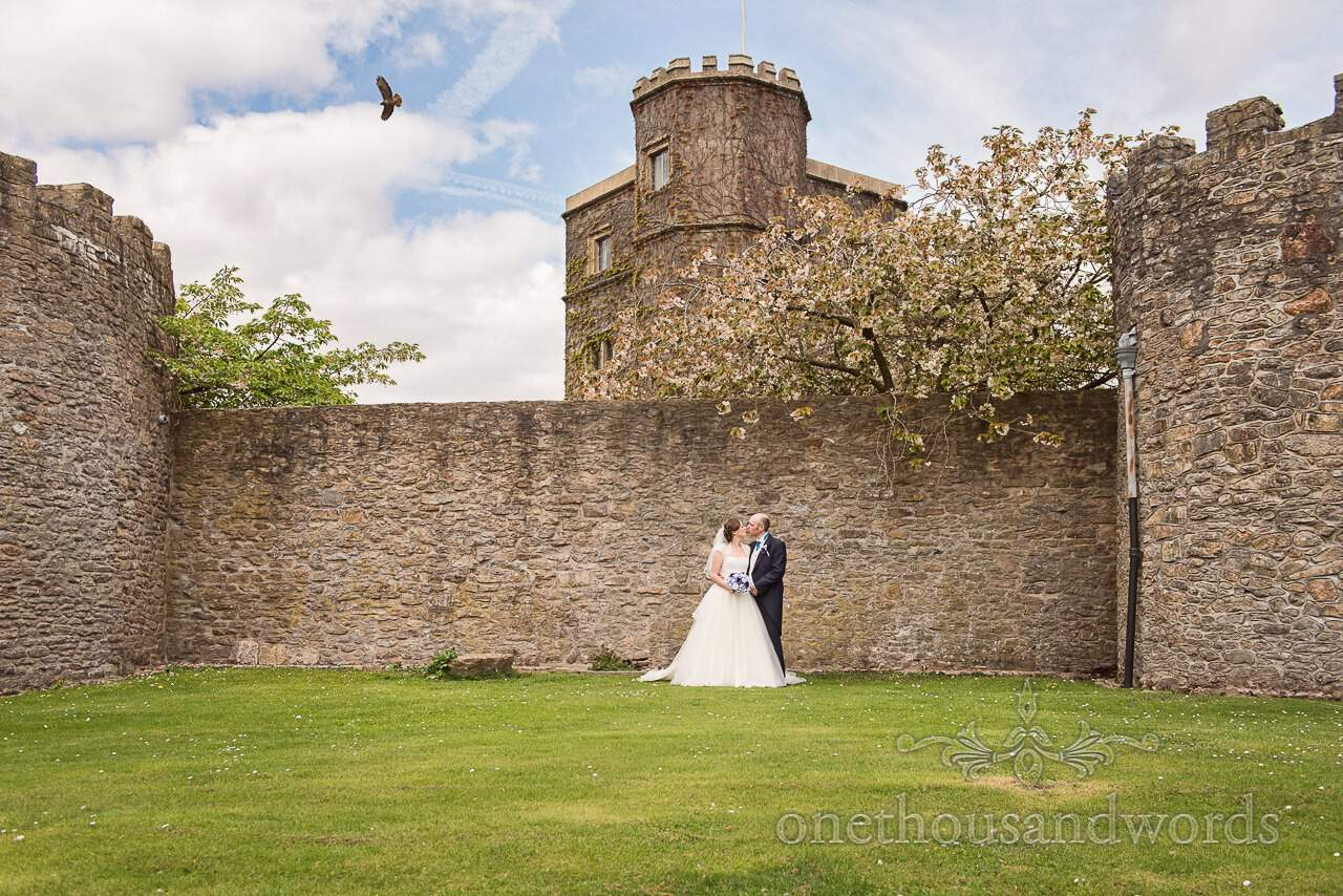 Bride and groom with photo bombing buzzard at Walton Castle wedding photographs