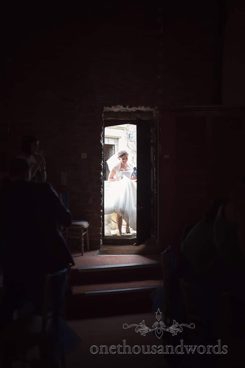Bride enters the room for wedding breakfast at Walton Castle wedding photographs