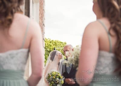 Bride gives a kiss before Scaplens Court wedding photographs