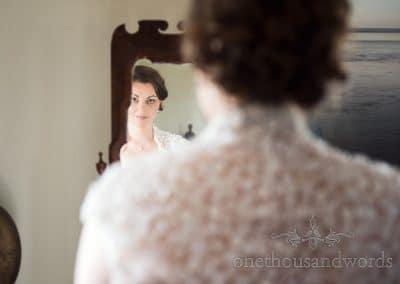 Bride in mirror on morning of Walton Castle wedding photographs