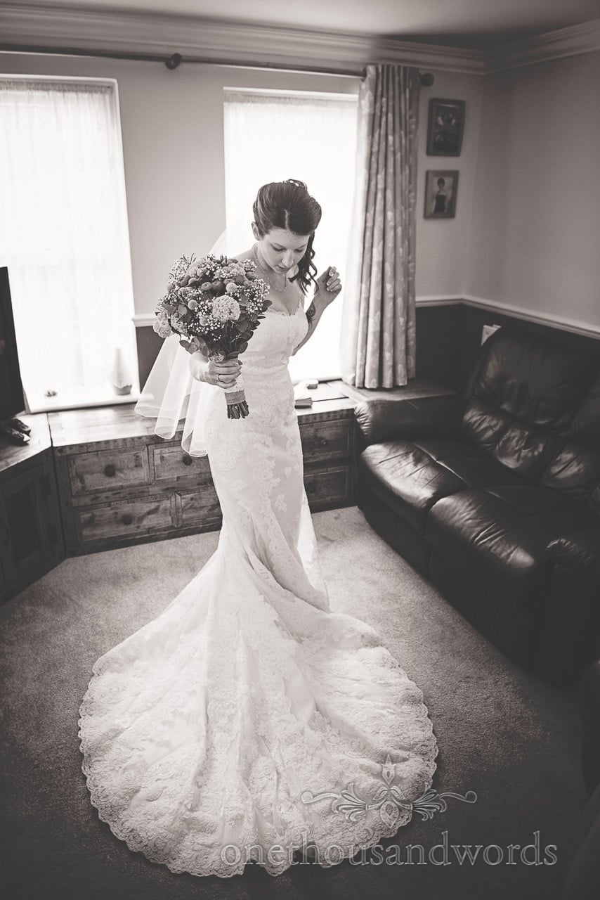 Bride in wedding dress on morning of Scaplens Court wedding photographs