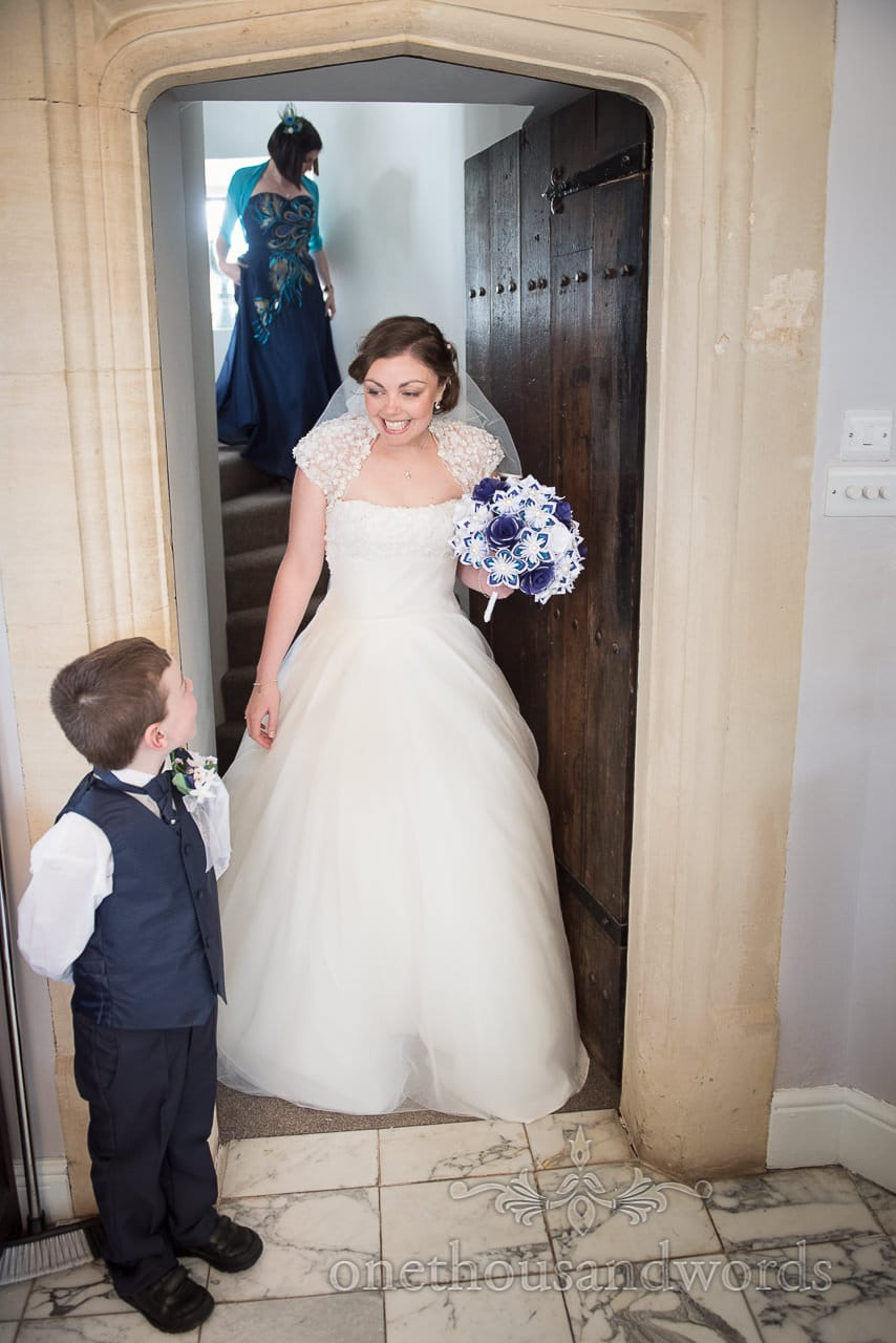 Bride is greeted by page boy at Walton Castle wedding photographs