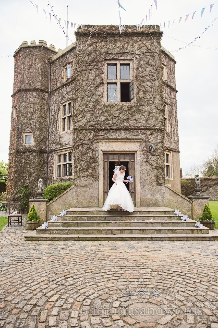 Bride outside the front of the castle at Walton Castle wedding photographs
