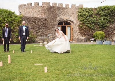 Bride plays lawn games from Walton Castle wedding photographs